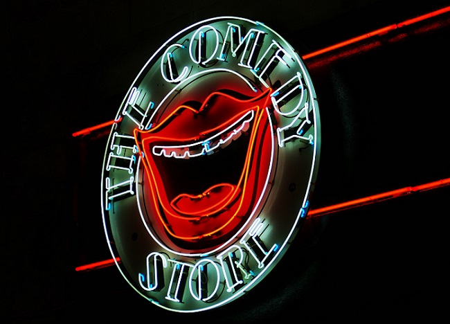 'The Comedy Store' neon sign with red lips and open mouth in the centre