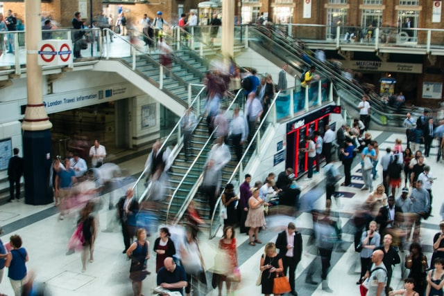 Blurred fast-paced picture of the London underground with blurred images of people walking around