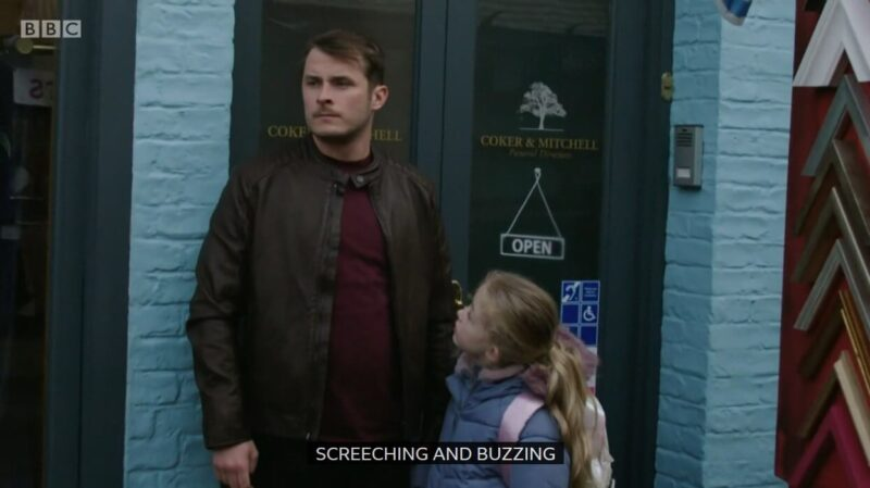 """Eastenders clip where Ben is holding his daugther's hand, gazing and the caption written is """"screeching and buzzing"""""""