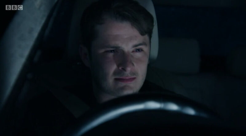 Ben in Eastenders driving and looking emotionally distressed with tears in his eyes