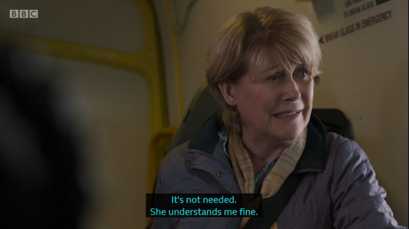 "Clip of Casualty episode where Theresa is sitting in the ambulance looking concerned and the caption is ""It's not needed. She understands me fine."""