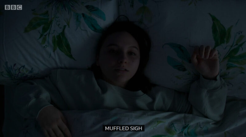"Clip of Casualty where Jade is waking up in the dark and the caption is written ""muffled sigh"""