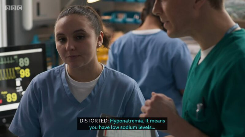 "Clip of Casualty episode where Jade is standing beside another nurse and the caption at the bottom is ""Distorted: Hyponatremia. It means you have low sodium levels..."""