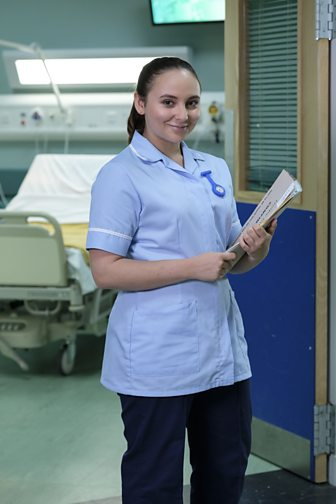 Jade from Casualty posing in front of the camera
