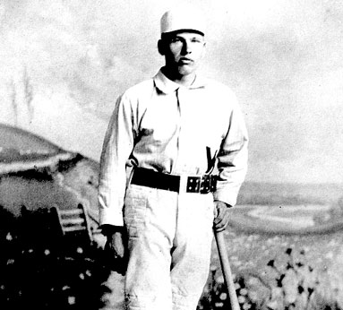 "Black and white picture of William Ellsworth, ""Dummy"" Hoy in a classic baseball gear, cap and holding a baseball bat beside him"