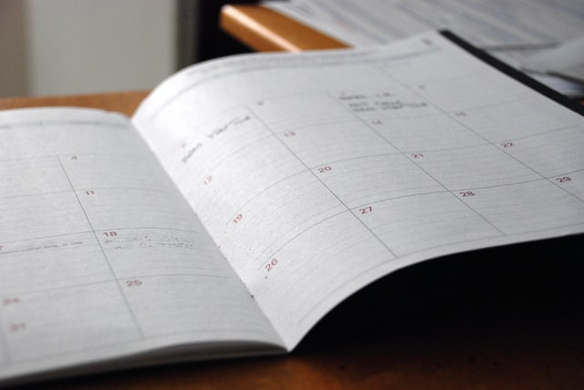 Photo of a diary opened at a month calendar