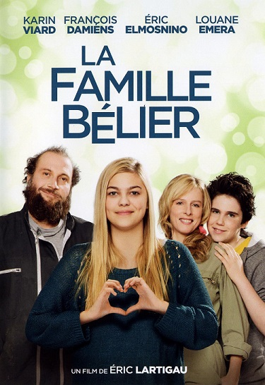 'La Famille Bélier' movie poster with 4 actors standing in front and one making heart-shaped with her hands