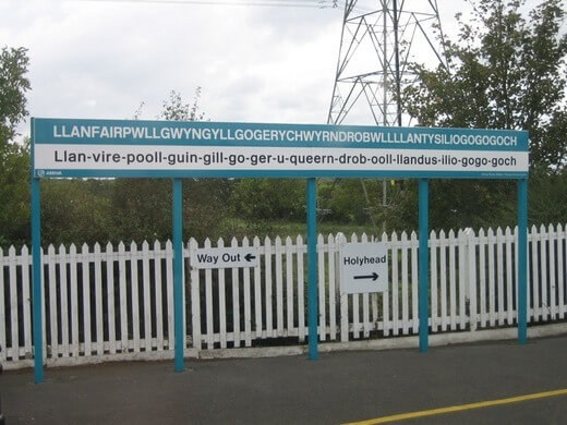 Sign of Llanfairpwllgwyngyll at a train station