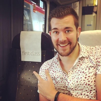 Profile picture of Ed Rex in first-class train seat