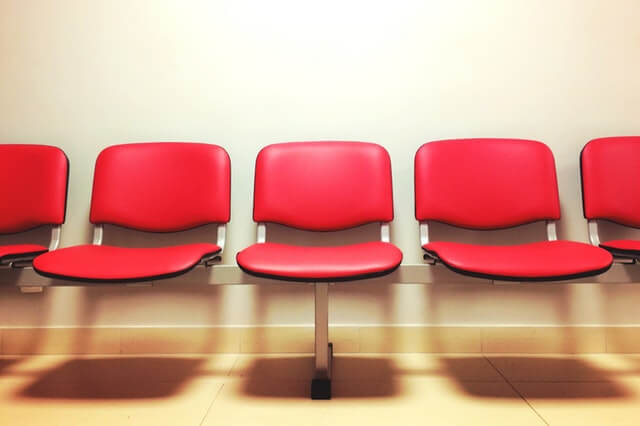Group of red chairs at a waiting room